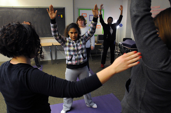 Salem:<br /> Genesis Marichal, center, along with Collins Middle School students in Sarah Mason's Learning Skills Classroom do yoga led by Sarah Mason.<br /> Photo by Ken Yuszkus/Salem,  News, Monday,  December 20, 2010.