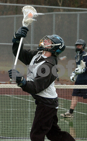 Peabody:<br /> Derek West catches the ball during a drill at practice. Because of the rain, the Peabody boys lacrosse team practiced on the tennis courts at the high school. <br /> Photo by Ken Yuszkus/Salem News, Monday, March 30, 2009.