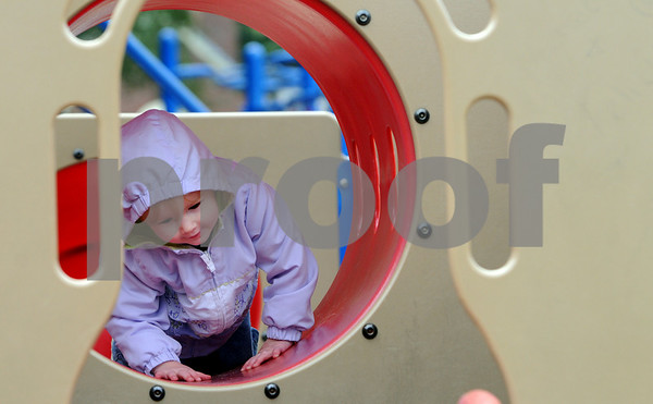 Hamilton:<br /> Ella Silver, 2, of Rockport, crawls through the tunnel that leads to the slide at Patton Park. She is enjoying the playground equipment with her father, Matt Silver, on monday.<br /> Photo by Ken Yuszkus/Salem News, Monday September 22, 2008.