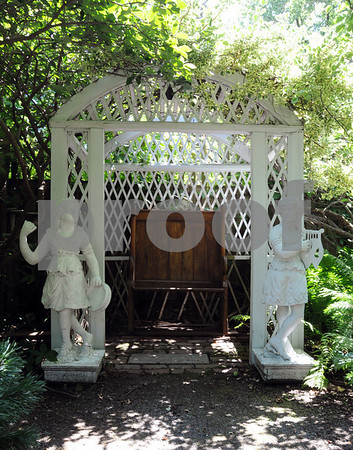Salem:<br /> The two statues flanking the alcove in the garden are from the original Salem Willows carousel. Jonathan and Jen Reardon's Chestnut Street garden will be featured on the Salem Garden Club's Garden Tour on July 11 and 12.<br /> Photo by Ken Yuszkus/Salem News, Monday, July 6, 2009.