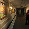 Salem:<br /> A patient and worker view the art from various artists in the hallway at Grosvenor Park Nursing Center.<br /> Photo by Ken Yuszkus/Salem News, Monday November 16, 2009.