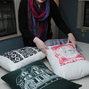 Peabody:<br /> Merritt Kirkpatrick, Director of  the Leatherworkers' Museum, has developed a private business on her own selling pillows, hand drawn and printed pillows featuring images of Salem (and other New England towns) houses, and other custom work.<br /> Photo by Ken Yuszkus/Salem News, Monday, May 23, 2011.