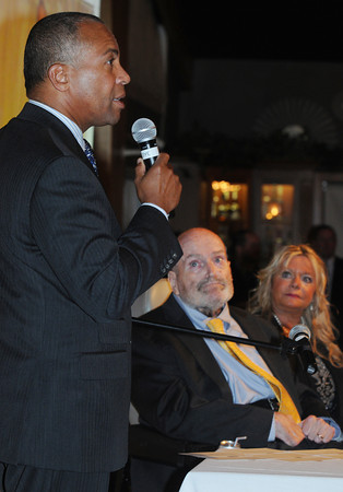 Danvers:<br /> Sen. Fred Berry and his wife Gayle listen to Gov. Deval Patrick speak about Sen. Berry at the Danversport Yatch Club. Sen. Fred Berry was feted in advance of his retirement, with a sold-out event that will benefit the Fred Berry Charitable Fund.<br /> Photo by Ken Yuszkus/The Salem News, Thursday, September 13, 2012.