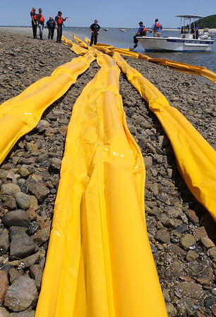 Ipswich:<br /> The regional marine oil spill training exercise at the mouth of the Ipswich River in Ipswich. The booms are laid out on the beach before they are dragged out to the water.<br /> Photo by Ken Yuszkus/Salem News, Tuesday, June 8, 2010.
