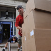 Salem:<br /> John O'Loughlin pushes a cart of boxes up the ramp into the moving truck. Jack Smitty is adjusting the ramp in the background. The Saltonstall School is moving.<br /> Photo by Ken Yuszkus/Salem News, Tuesday, August 16, 2011.