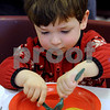 Peabody:<br /> David Donahue, 4, of Peabody, slices his pancake at the Breakfast With Santa at the South Branch Library while waiting for Santa to arrive.<br /> Photo by Ken Yuszkus/Salem News, Wednesday December 10, 2008.