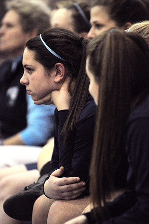 Marblehead:<br /> Carli Ciacchino of the Peabody High School girls varsity basketball team watches intently while on the bench at the Peabody High School vs Marblehead High School girls varsity basketball game at Marblehead.<br /> Photo by Ken Yuszkus/Salem News, Tuesday, January 11, 2011.