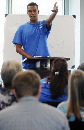 Salem:<br /> Ariel Villalona speaks at the podium about his findings during the STAND presentation. Kids from the Point concluded a summer long project investigating problems in the Point and Gloucester Crossing.<br /> Photo by Ken Yuszkus/Salem News, Thursday, August 11, 2011.