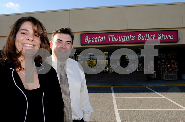 Salem:<br /> Kathy and Rich Alimenti stand in front of Special Thoughts Outlet Store, which they own.<br /> Photo by Ken Yuszkus/Salem News, Friday November 21, 2008.