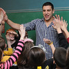 Peabody:<br /> Milan Lucic high fives students after taking a group photo. Milan Lucic was visiting Harolyn Fucile's and Lisa Tivnan's third-grade classes at the West Memorial School on Friday afternoon.<br /> Photo by Ken Yuszkus/Salem News, Friday,  March 9, 2012.