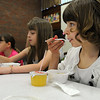 Peabody:<br /> Alice Goncalves, left, 3rd grade, and Sarah Ciman, 5th grade, eat breakfast at the Welch School on Tuesday morning.<br /> Photo by Ken Yuszkus/Salem News, Tuesday, June 15, 2010.
