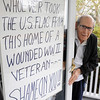 "Beverly:<br /> World War II veteran Joseph Quattrochi had his American flag stolen. He has flown a flag on his front porch since he moved into his house 42 years ago, but it was stolen two weeks ago. He has written a large sign saying ""Shame on You!!"" and taped it to his front door. <br /> Photo by Ken Yuszkus/Salem News, Thursday,  November 4, 2010."