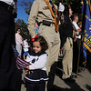 Danvers:<br /> Madeline Martin, second cousin to Karen Martin who was the head flight attendant on flight 11 who perished on 9/11, waves the U.S. flag during the 9/11 ceremony at New Brothers Restaurant Sunday morning. Steward Wood, who was part of the color guard, looks on.<br /> Photo by Ken Yuszkus/Salem News, Sunday, September 11, 2011.
