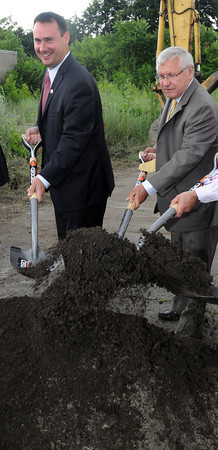 Peabody:<br /> Peabody Mayor Edward Bettencourt, left, and former Mayor Michael Bonfanti dig into a pile of dirt at the groundbreaking at the site of a new park on Walnut Street.<br /> Photo by Ken Yuszkus/Salem News, Wednesday, June 27,  2012.