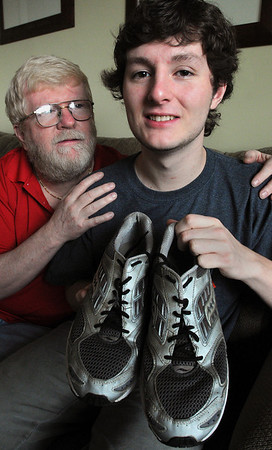 Salem:<br /> Chris Cocozella, right, is running the marathon for his dad, Mike, left, who was recently diagnosed with cancer. Chris gave his dad a pair of running shoes (in Chris' size) this past Christmas and then told him he was running the marathon this year and raising money for his dad. Chris is holding the running shoes that he gave his father.<br /> Photo by Ken Yuszkus/Salem News, Saturday, April 17, 2010.