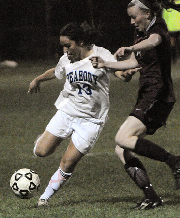 Peabody:<br /> Peabody's Victoria Digiacomo, left, kicks the ball during the Westford Academy at Peabody State tournament girls soccer game in Division 1 North.<br /> Photo by Ken Yuszkus/Salem News, Monday, November 7, 2011.