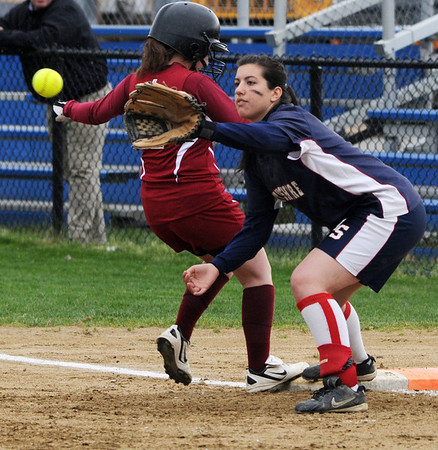 Middleton:<br /> North Shore Tech/Essex Aggie's first baseman, Kaila Lane gets the throw at first, but the Mystic Valley player gets back to first safe after a pop fly ball was caught at the North Shore Tech/Essex Aggie softball game vs. Mystic Valley.<br /> Photo by Ken Yuszkus/Salem News, Monday, May 9, 2011.