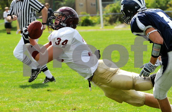 Swampscott:<br /> Gloucester's Christopher Unis reaches and catches a long pass to him during the first quarter at the Swampscott vs Gloucester foootball game at Blocksidge Field.<br /> Photo by Ken Yuszkus/Salem News, Sunday, September 13, 2009.