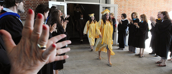 Peabody:<br /> The Bishop Fenwick faculty clap as the seniors file pass them just before the processional at the Bishop Fenwick graduation.<br /> Photo by Ken Yuszkus/Salem News, Friday, May 28, 2010