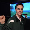 Middleton:<br /> Caleb Reinhold, general manager at Optigolf, stands in front of the projection screen at one of the nine simulators at the indoor golf facility.<br /> Photo by Ken Yuszkus/Salem News, Thursday, December 15, 2011.