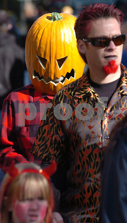 Salem:<br /> Paul Levengood of New Baltimore, Michigan, walks through the crowded Essex Street with a plastic pumpkin over his head in the afternoon. Thousands are expected to descend upon Salem tonight for Halloween.<br /> Photo by Ken Yuszkus/Salem News, Friday, October 31, 2008.