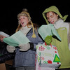 Beverly:<br /> From left, Marissa Dumond, of Beverly, Leslie Jamison, of Topsfield, and Sara DeBaere, of Beverly, sing carols. Besides, Christmas carols, gifts were given out by the group walking in the Gloucester Crossing neighborhood.<br /> Photo by Ken Yuszkus/Salem News, Tuesday, December 22, 2009.