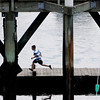 Beverly:<br /> A boy runs along the dock at the Beverly wharf on Wednesday morning.<br /> Photo by Ken Yuszkus/Salem News, Wednesday, June 22, 2011.