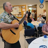 DAnvers:<br /> Paul Wayne sings and plays his guitar to entertain the people gathered at the Danvers Senior Center for the Family Festival. Roberta Kodis, right, listens to his music.<br /> Photo by Ken Yuszkus/Salem News, Tuesday, June 28, 2011.