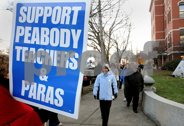 Peabody:<br /> Protesters march around Peabody City Hall in support of Peabody teachers and paraprofessionals Tuesday afternoon. <br /> Photo by Ken Yuszkus/Salem News, Monday November 18, 2008.