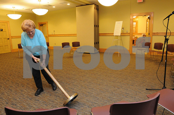 Middleton:<br /> Shirley Raynard, president of the Friends of the Flint Public Library, moves a pedestal as she readies the large new meeting room for the opening ceremonies. Saturday was the re-dedication ceremony for the renovation of the addition to the Flint Public Library.<br /> Photo by Ken Yuszkus/Salem News, Saturday, November 8, 2008.