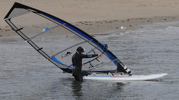 Beverly:<br /> Dave Winslow readies to leave the beach at Independence Park on his sailboard. The strong wind on Wednesday was for good windsurfing. <br /> Photo by Ken Yuszkus/Salem News, Wednesday, December 28, 2011.