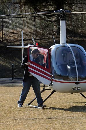 Danvers:<br /> St. John's Prep, senior Erik Slettehaugh of Groveland, exits the helicopter he flew over the Cronin Stadium at St. John's Prep school where he eventually landed.<br /> Photo by Ken Yuszkus/Salem News, March 10, 2010.