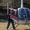 Danvers:<br /> St. John's Prep, senior Erik Slettehaugh of Groveland, exits the helicopter he flew over the Cronin Stadium at St. John's Prep school where he eventually landed.<br /> Photo by Ken Yuszkus/Salem News, March 10, 2010.