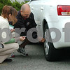 Beverly:<br /> Matt Herring, right, checks the tire pressure of Andrea Fox's, tires. He teaches super commuter driving classes.<br /> Photo by Ken Yuszkus/Salem News, Thursday, June 18, 2009.