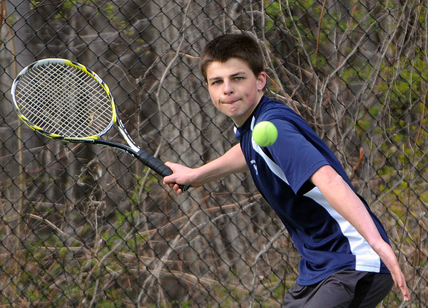 Swampscott:<br /> Swampscott's Sam Crimmons keeps his focus on the ball as he prepares to swing during the Peabody at Swampscott boys tennis match at Swampscott Middle School tennis courts.<br /> Photo by Ken Yuszkus/Salem News, Monday, April 9, 2012.
