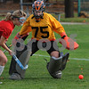 Danvers:<br /> Abbey Fleming, of Beverly, goalie for Squad One, goes after the ball while covering her goal during the Northeastern Conference all-stars field hockey game at Danvers high School.<br /> Photo by Ken Yuszkus/Salem News, Sunday November 1, 2009.