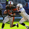 Foxboro:<br /> Kenny Pierce has a Scituate player on his heels during the Beverly vs Scituate in the Division 3 Super Bowl at Gillette Stadium on Saturday.<br /> Photo by Ken Yuszkus/Salem News, Saturday, December 4, 2010.
