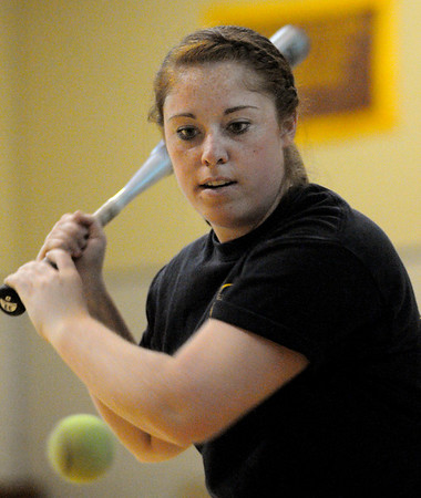 Peabody:<br /> Bishop Fenwick's Taylor Ahearn at softball practice in the gym at Bishop Fenwick on Tuesday.<br /> Photo by Ken Yuszkus/Salem News, Tuesday, April 19, 2011.