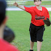 Salem:<br /> Carson Connor of the Salem Little League All-Stars tosses the ball to his teammate during practice at Forest River Park.<br /> Photo by Ken Yuszkus/Salem News, Thursday, June 28,  2012.