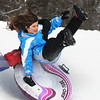 Beverly:<br /> Sarah Hall, 8, and Ceirra Merritt, 7, in back, are airborne after hitting a jump while sledding at Lynch Park in Beverly. <br /> Photo by Ken Yuszkus/Salem News, Friday, January 14, 2011.