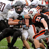 Beverly:<br /> Marblehead's Will Quigley hits a wall of Beverly's players during the Marblehead at Beverly football game in Hurd Stadium on Saturday.<br /> Photo by Ken Yuszkus/Salem News,  Saturday,  November 6, 2010.