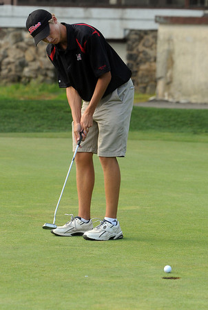 Beverly:<br /> Chris Neuman of Marblehead, putts toward the 11th hole at the Beverly Golf & Tennis Club during the Marblehead at Beverly high school golf match.<br /> Photo by Ken Yuszkus/Salem News, Tuesday,  September 7, 2010.