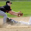 Beverly:<br /> Beverly's Chris Mitchell gets the throw, but Peabody's Jimmy Leavitt is safe on second base at the Peabody at Beverly baseball game at Cooney Field.<br /> Photo by Ken Yuszkus/Salem News, Wednesday, April 21, 2010.