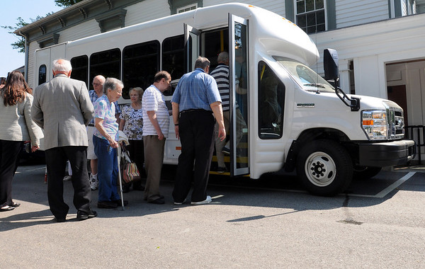 Middleton:<br /> Seniors board the new van to take it's maiden trip from the parking lot of the Council on Aging.  <br /> Photo by Ken Yuszkus/Salem News, Wednesday, May 26, 2010.