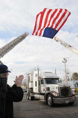 Topsfield:<br /> Cheering and clapping greeted the Wreaths Across America procession as it drives through the gate of the Topsfield Fairgrounds. They will eventually end their trip in Arlington National Cemetery.<br /> Photo by Ken Yuszkus/Salem News, Monday, December 5, 2011.