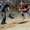 Wenham:<br /> Rob Meulenberg runs with a bungee cord attached to see how far he can travel with the resistance from the cord as a cameraman follows his progress. The Discovery Channel film crew were filming at Gull Pond at Gordon College.<br /> Photo by Ken Yuszkus/Salem News, Friday, April 17, 2009.