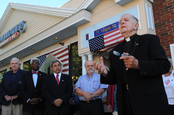 Danvers:<br /> Father Gerald Dorgan says a prayer during the 9/11 ceremony at New Brothers Restaurant Sunday morning.<br /> Photo by Ken Yuszkus/Salem News, Sunday, September 11, 2011.