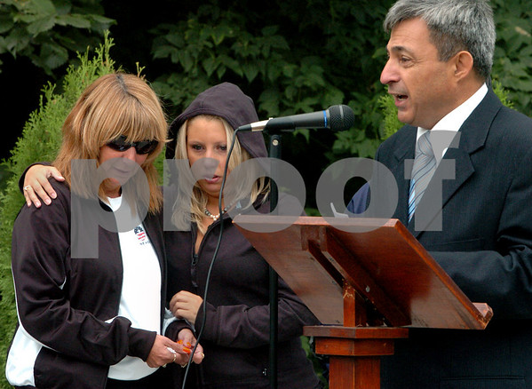 Peabody:<br /> From left, Linda LeBlanc and her daughter Lucille LeBlanc stand near State Representative Ted Speliotis as he speaks at the dedication of the Peabody 9/11 Memorial Park. Linda LeBlanc and her daughter Lucille LeBlanc are some of the family members present who are representing Janis Lasden.  Janis Lasden was one of the three people from Peabody killed on 9/11.<br /> Photo by Ken Yuszkus/Salem News, Friday, September 11, 2009.