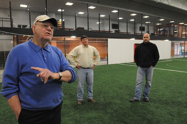 Danvers:<br /> Don Cragg talks about the indoor sports complex and the popularity of such buildings. Mark Mscisz, center, and Kelly Cragg, right, listen while at Danvers Indoor Sports.<br /> Photo by Ken Yuszkus/Salem News, Friday,  March 9, 2012.