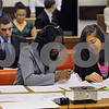 Peabody:<br /> Emirah Peaten, left, and Marisa Chiulli, both prosecuting attorneys, search for paperwork during the mock trial at Peabody District Court. Peabody High School students used the courtroom on thursday morning to conduct the trial.<br /> Photo by Ken Yuszkus/Salem News, Thursday, April 30, 2009.